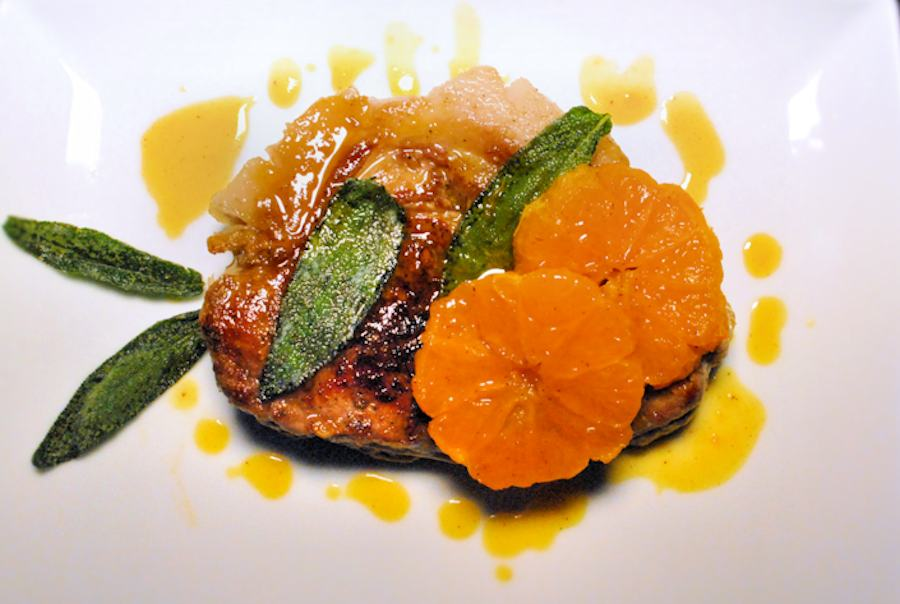 Pork steak with clementines and sage
